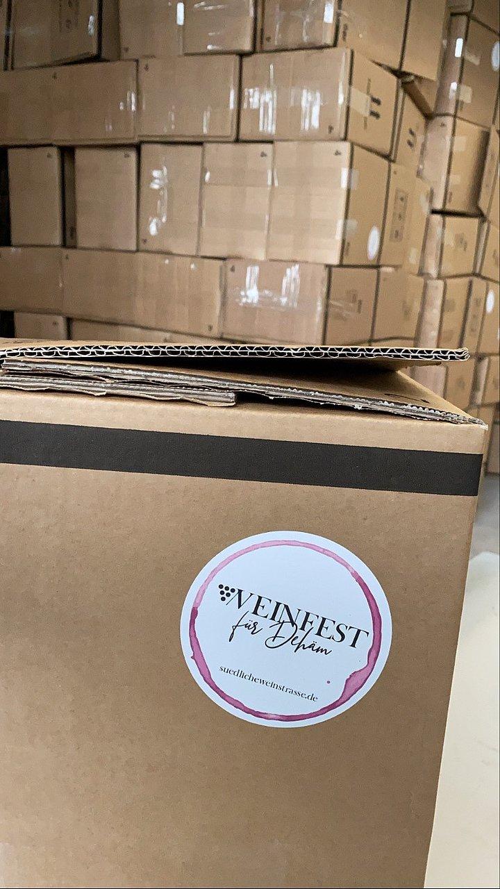 Weinfest Dehäm Pakete packen